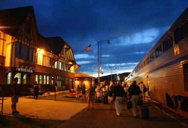 Summer travelers depart Amtrak's Empire Builder at the Historic Whitefish Train Depot.