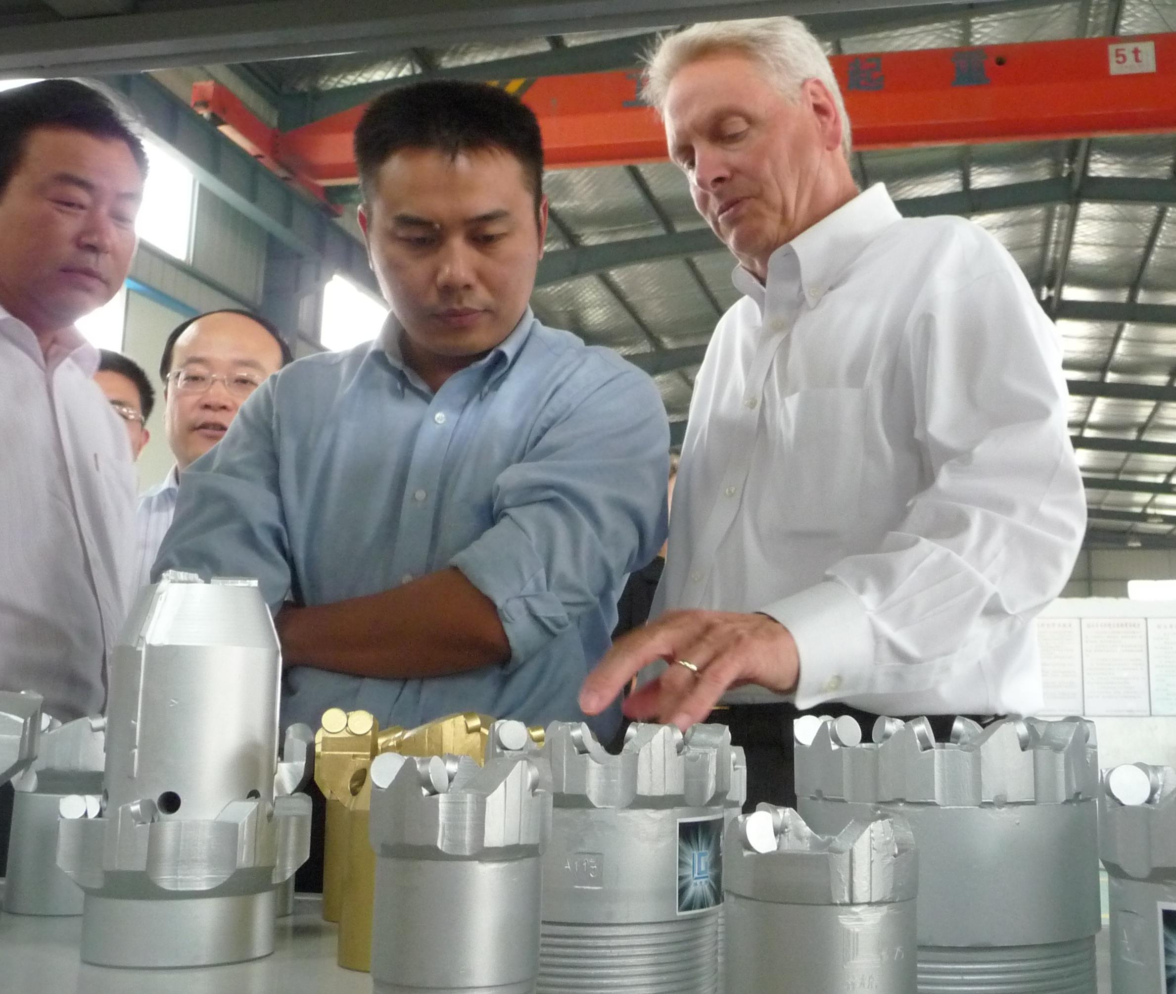 :David Hall examining drill bits.JPG